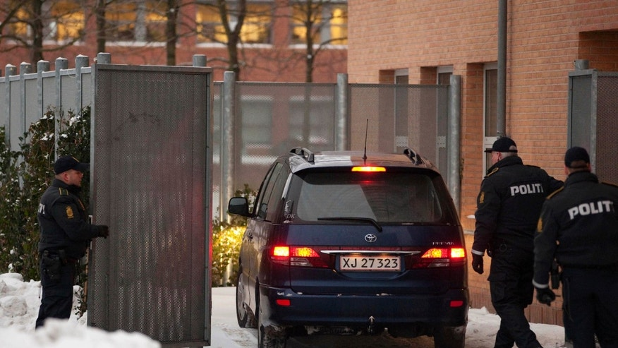 Dec. 30: Danish police officers stand guard as a suspect arrested on suspicion of planning a shooting attack on the office of a newspaper that published cartoons of the Prophet Muhammad arrives at a court in Glostup, south of Copenhagen.