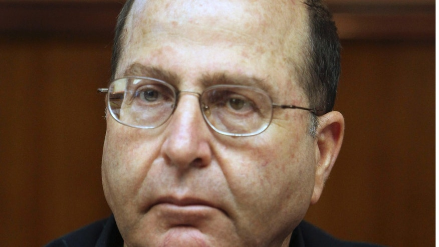 In this 2009 file photo, Israel's deputy prime minister and minister of strategic affairs Moshe Ya'alon attends the weekly cabinet meeting at the Prime Minister's office in Jerusalem. Ya'alon said Dec. 29 that technical difficulties have pushed back the Iranian timetable for producing a nuclear weapon.