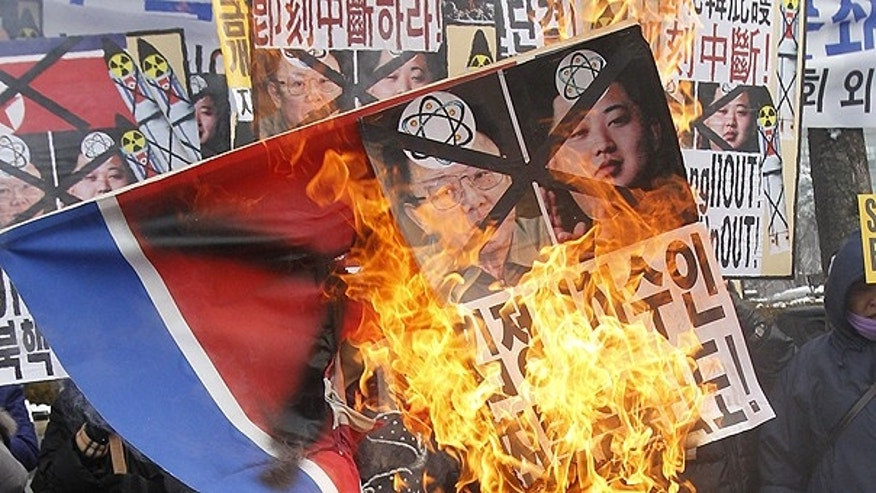 Dec. 28: Anti-North Korea protesters burn a North Korea flag and pictures of North Korean leader Kim Jong Il and his youngest son Kim Jong Un during a rally in Seoul, South Korea.