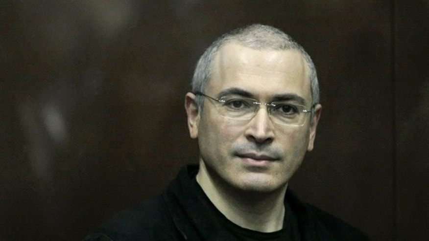 Dec. 30: Mikhail Khodorkovsky, 47, looks on from behind a glass enclosure at a court room in Moscow. (AP)