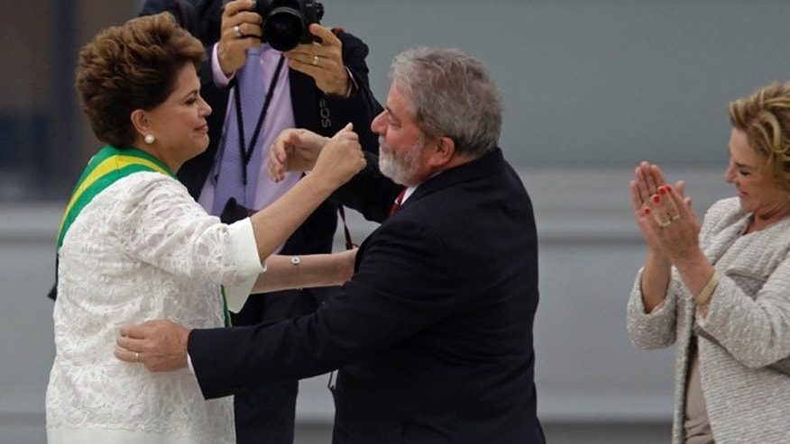 Jan. 1, 2011: Brazil´s outgoing President Luiz Inacio Lula da Silva embraces Brazil's President Dilma Rousseff after placing the presidential sash on her at the Planalto palace in Brasilia, Brazil