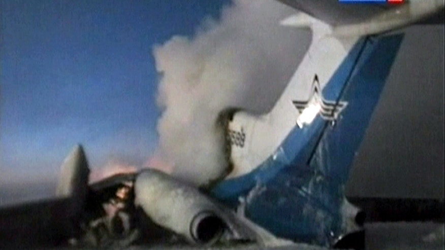 In this image taken from Russia 24 television channel TV, showing a tail part of the Russian passenger Tu-154 aircraft seen after an explosion in Surgut, about 1,350 miles east of Moscow, Russia, Saturday, Jan. 1, 2011.