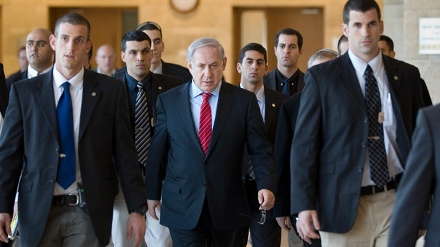 Jan. 3: Israeli Prime Minister Benjamin Netanyahu, center, surrounded by bodyguards, arrives at a Foreign Affairs and Security Committee meeting in the Knesset, Israel's parliament, in Jerusalem. (AP)