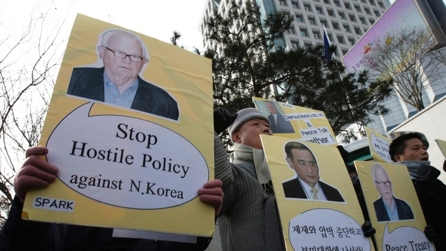 Jan. 5: South Korean protesters with portraits of U.S. special envoy on North Korea, Stephen Bosworth shout slogans during a rally against the United States and South Korean government's policies on North Korea in front of the Foreign Ministry in Seoul, South Korea. Bosworth arrived Monday to discuss ways to deal with North Korea amid lingering tension following the North's artillery attack on a front-line island that killed four South Koreans in last year's November.