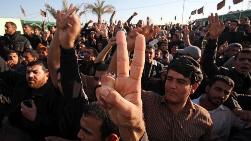 Jan. 6: Supporters of anti-American cleric Muqtada al-Sadr  gather outside his home in the Shiite city of Najaf, Iraq.