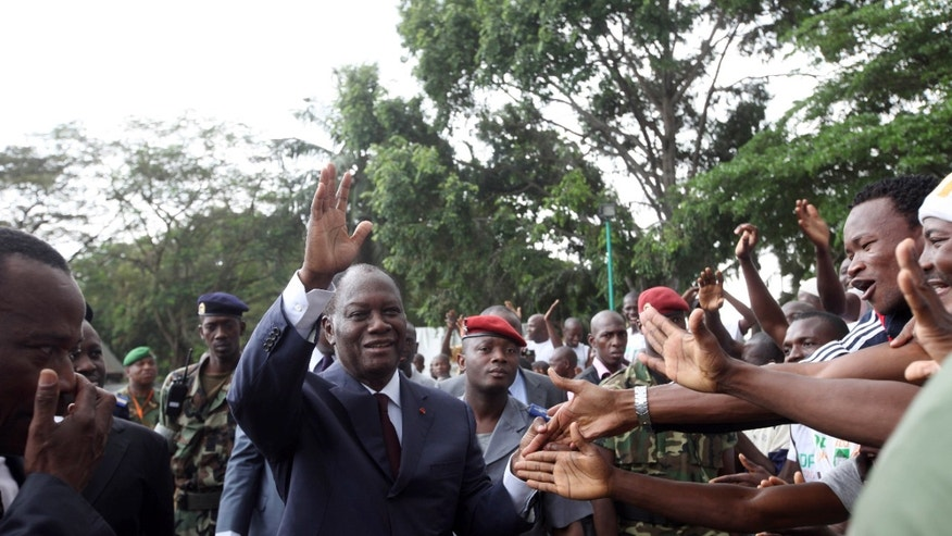 Dec. 30, 2010: Alassane Ouattara, centre, opposition leader greet his supporters in Abidjan, Ivory Coast.  Ouattara is widely regarded as being the winner of recent presidential elections, although incumbent leader Laurent Gbagbo refuses to relinquish power.  The United Nations accused Gbagbo's security forces of blocking access to sites thought to hide the bodies of up to 80 victims amidst reports that political opponents were abducted by security forces loyal to Gbagbo after the disputed election.