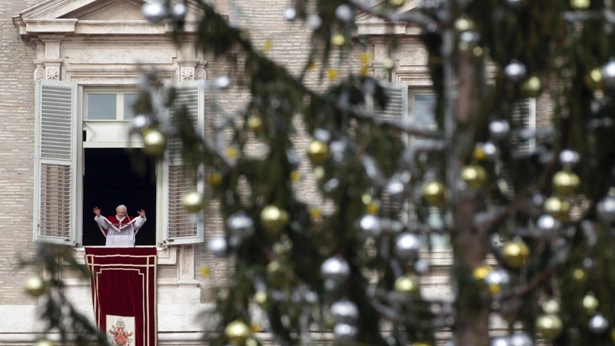 Jan. 6, 2011: Pope Benedict XVI, framed by a Christmas tree, delivers his blessing from his studio window overlooking St. Peter's Square following an Epiphany Mass, at the Vatican. Benedict XVI is stunned by the wave of violence and intolerance toward Christians around the world, Italy's top churchman said at Epiphany services.