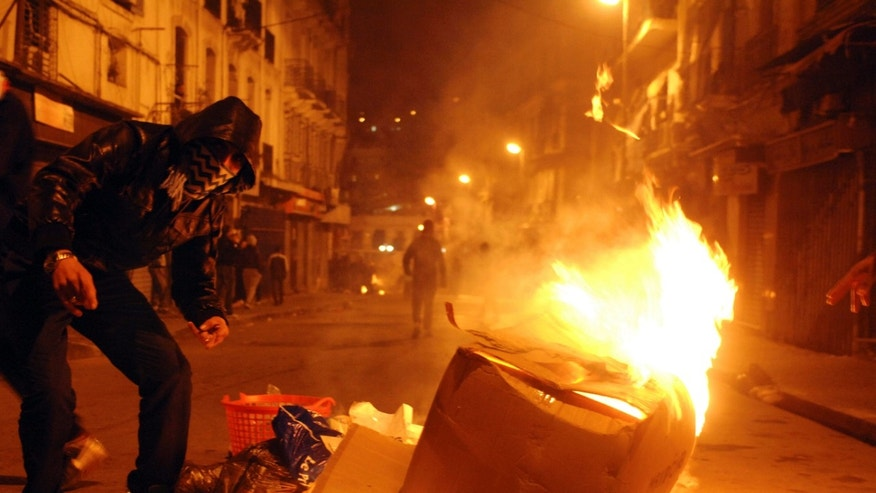 Jan. 6, 2011: Youth set fires in the streets of the Belcourt district of Algiers, during the night as part of a protest over the rising cost of living. Violence came after price hikes for milk, sugar and flour in recent days, and amid simmering frustration that Algeria's abundant gas-and-oil resources have not translated into broader prosperity.