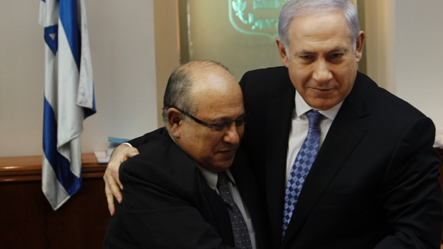 Israel's Prime Minister Benjamin Netanyahu, right, hugs Meir Dagan, outgoing director of Mossad, Israel's spy agency, after thanking him at the beginning of the weekly cabinet meeting in Jerusalem.