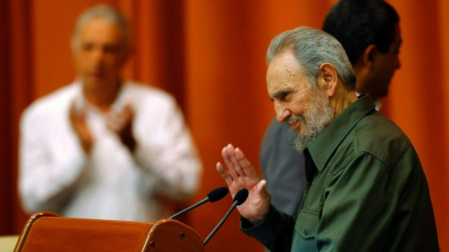 Fidel Castro waves during a special session of parliament, his first official government appearance in front of lawmakers in four years in Havana, Cuba, Saturday Aug. 7, 2010. (AP Photo/Frankly Reyes)