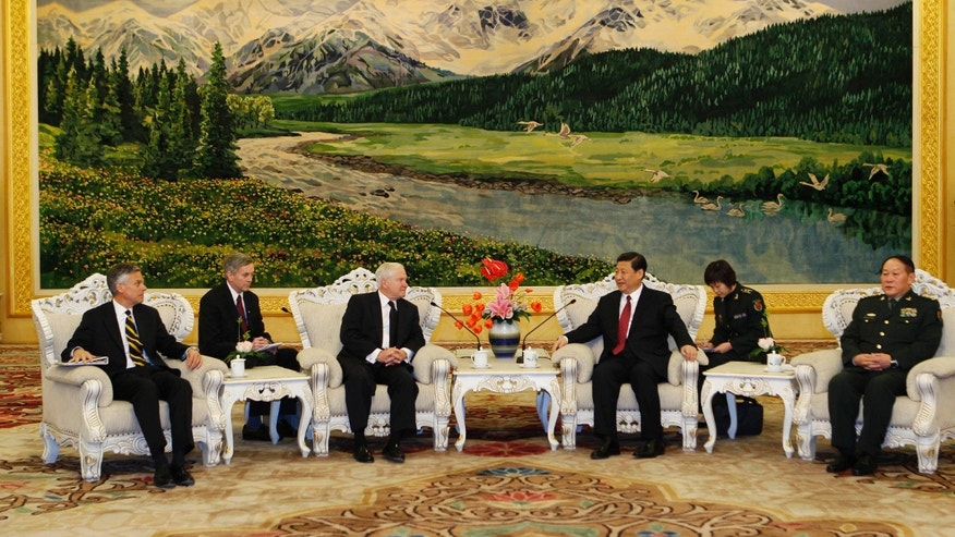 Jan. 10, 2011: U.S. Secretary of Defense Robert Gates, third from left, and Chinese Vice President Xi Jinping, third from right, sit with members of their delegation during a meeting at the Great Hall of the People in Beijing. (AP)