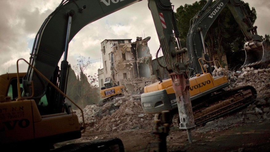 Jan. 9, 2011: Israeli bulldozers demolish the Shepherd Hotel in the east Jerusalrmem neighborhood of Sheik Jarrah. Bulldozers demolished the hotel in an Arab east Jerusalem neighborhood Sunday to make way for a new Israeli enclave, moving ahead with a plan that has angered the Palestinians and the U.S. (AP)