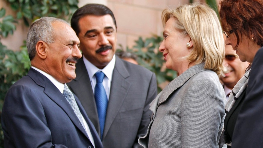 Jan. 11: Yemeni President Ali Abdullah Saleh, left, shakes hands with U.S. Secretary of State Hillary Rodham Clinton, as she arrives at the Presidential Palace in Sanaa, Yemen.