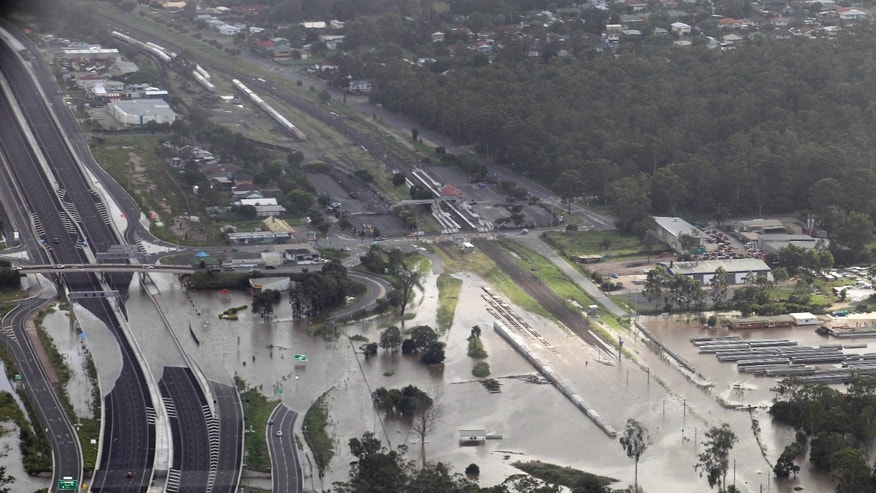 Jan. 12, 2011: A main road is submerged outside Ipswich, west of Brisbane, Australia. Emergency sirens blared across Australia's third-largest city Wednesday as floodwaters that have torn a deadly path across the northeast poured into an empty downtown, swamping neighborhoods in what may be Brisbane's worst flooding in 100 years. (AP)