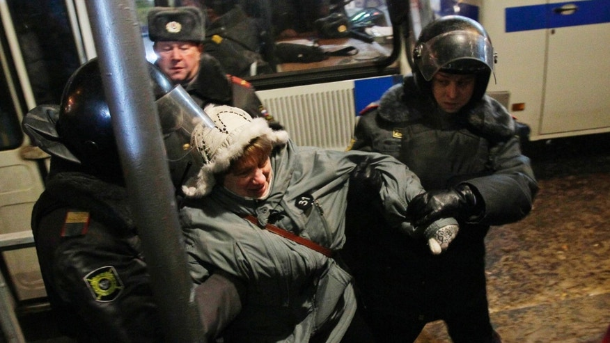 Riot police officers detain a protester during a rally in central Moscow, Russia, Friday, Dec. 31, 2010. The Russian opposition protests on the 31st of each month are a nod to the 31st article of the Russian constitution, which guarantees the right of assembly.