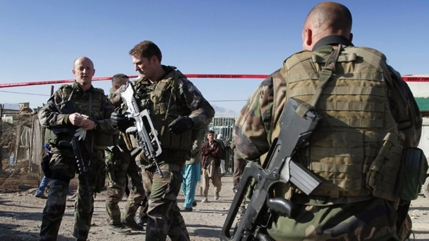 Jan. 12: French soldiers with the NATO-led International Security Assistance Force (ISAF) are seen at the scene of a suicide attack in Kabul, Afghanistan.