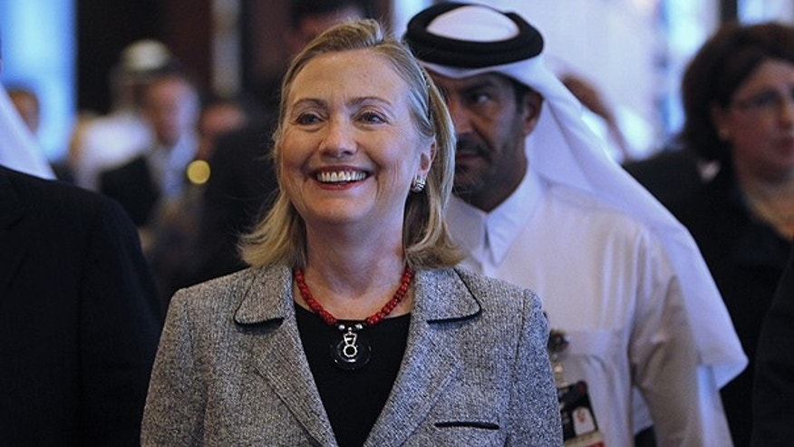 Jan. 13: U.S. Secretary of State Hillary Rodham Clinton walks into the Forum for the Future conference in Doha, Qatar.