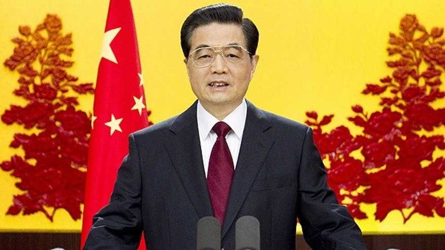 Dec. 31, 2010: Chinese President Hu Jintao delivers a New Year's address in Beijing.