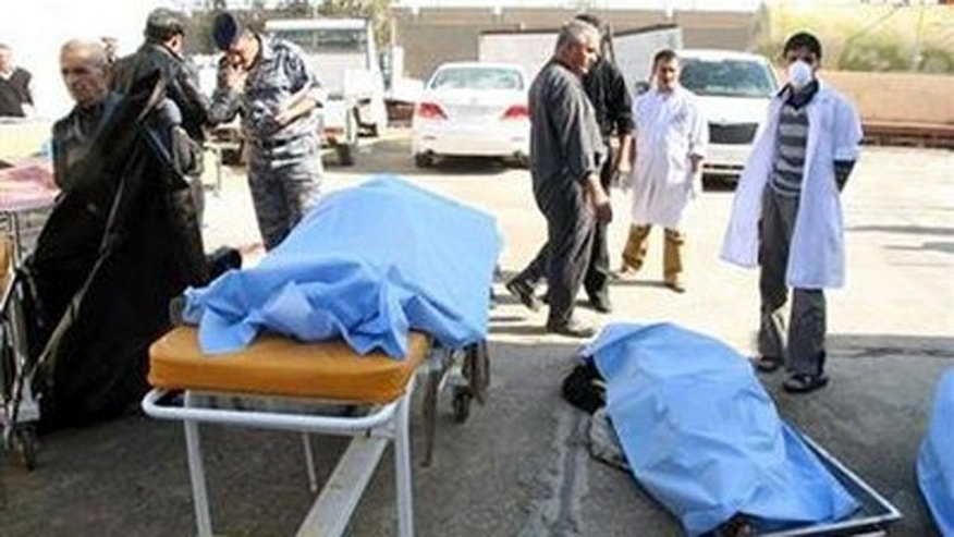 Jan. 18: Bodies of bomb attack victims are seen outside a hospital in Tikrit, some 95 miles north of Baghdad.