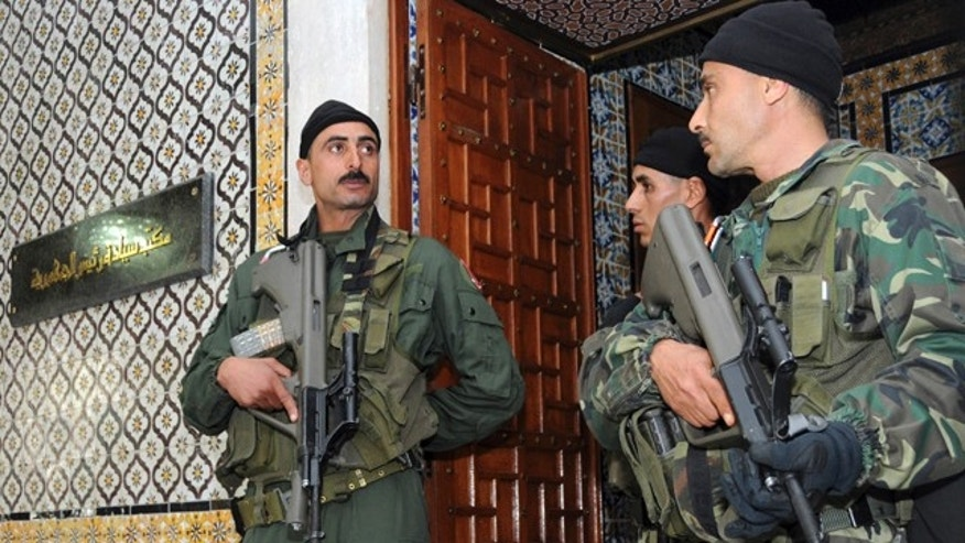 Jan. 17: Soldiers guard the office of the Tunisian President in Tunis.