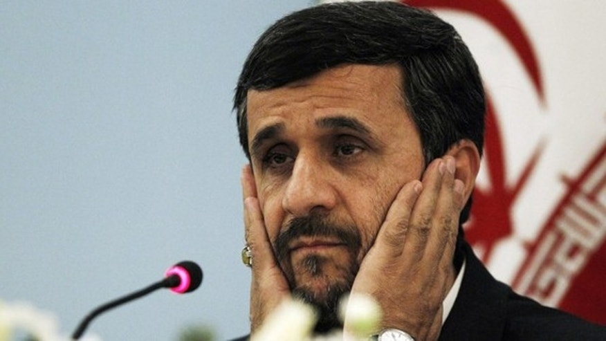 Iranian President Mahmoud Ahmadinejad addresses the media during a news conference in Istanbul December 23, 2010.