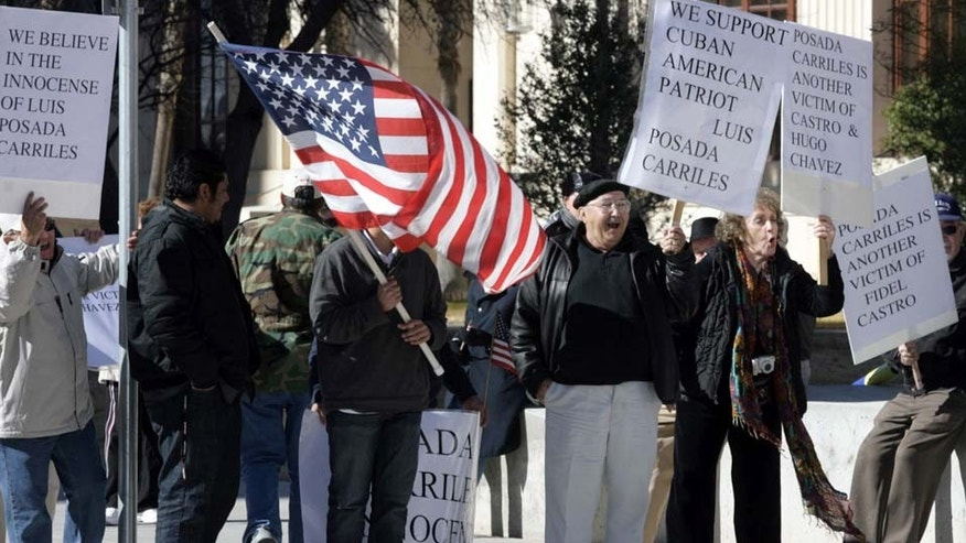 Members of the Cuban community hold a protest calling for the release of Luis Posada Carriles in front of the Albert Armendariz Sr. Federal Courthouse in El Paso, Texas, Monday, Jan. 10, 2011. Jury selection has begun on charges Posada lied to federal immigration officials after he sneaked into the U.S. in 2005 — not about his past as a former CIA operative and cold warrior. (AP Photo/The El Paso Times, Ruben R. Ramirez)  EL DIARIO OUT; JUAREZ MEXICO OUT; IF USE ON LAM OR LAT AND EL DIARIO DE EL PASO OUT