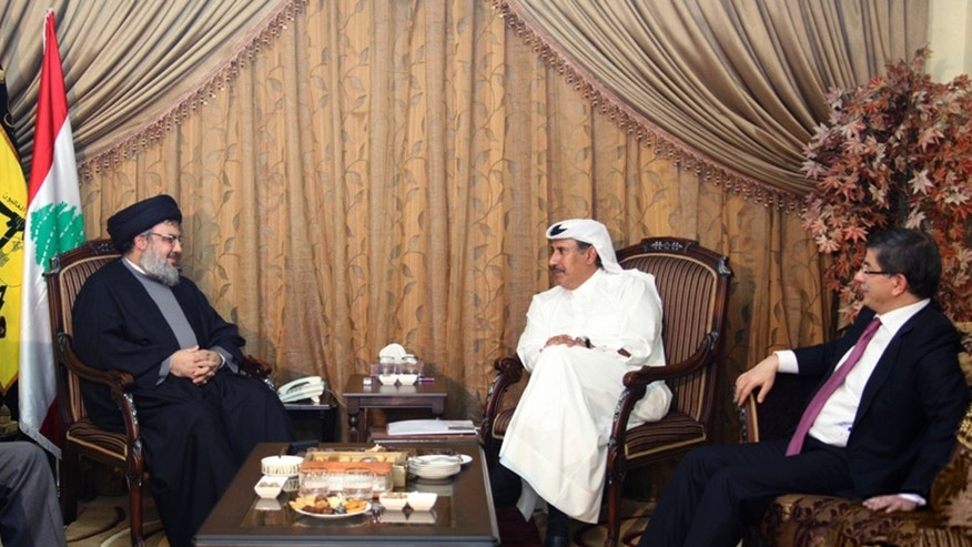 In this photo released by Hezbollah Media Office on Tuesday, Jan. 18, 2011, from left, Hussein Khalil, the political adviser to Hezbollah leader Sheik Hassan Nasrallah, listens as Nasrallah meets with Qatar's Prime Minister Sheikh Hamad bin Jassim bin Jabr Al-Thani and Turkish Foreign Minister Ahmet Davutoglu, in Beirut, Lebanon. Saudi Arabia has abandoned efforts to mediate in Lebanon's political crisis, removing a key U.S. ally from talks to ease tensions after Hezbollah toppled the government in Beirut last week.