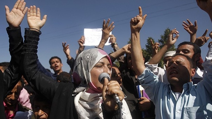 Jan. 22: Yemeni students chant slogans calling on their president Ali Abdullah Saleh to leave the government and follow Tunisian ousted President Zine El Abidine Ben Ali into exile during a protest in Sanaa, Yemen.