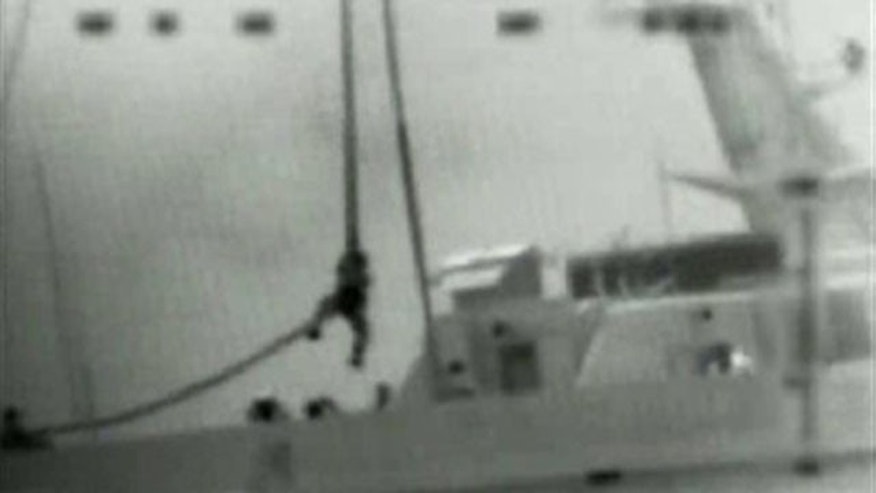 May 31, 2010: This image made from video provided by the Israeli Defence Force shows what the IDF says is one of several commandos being dropped onto the Mavi Marmara ship by helicopter in the Mediterranean Sea. Israeli commandos rappelled down to an aid flotilla sailing to thwart a Gaza blockade on Monday, clashing with pro-Palestinian activists on the lead ship in a raid that left at least nine passengers dead.