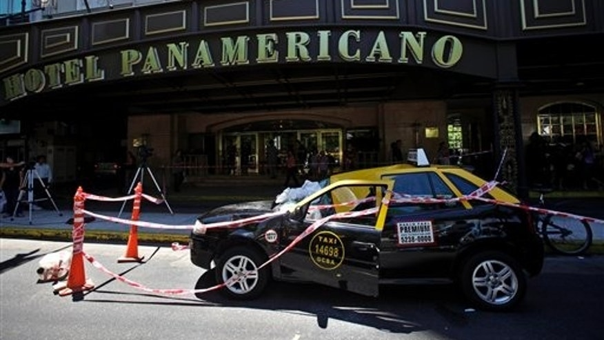Jan. 24, 2011: A damaged taxi is seen after being hit by a woman who survived after jumping from the 23rd story of a Buenos Aires hotel.