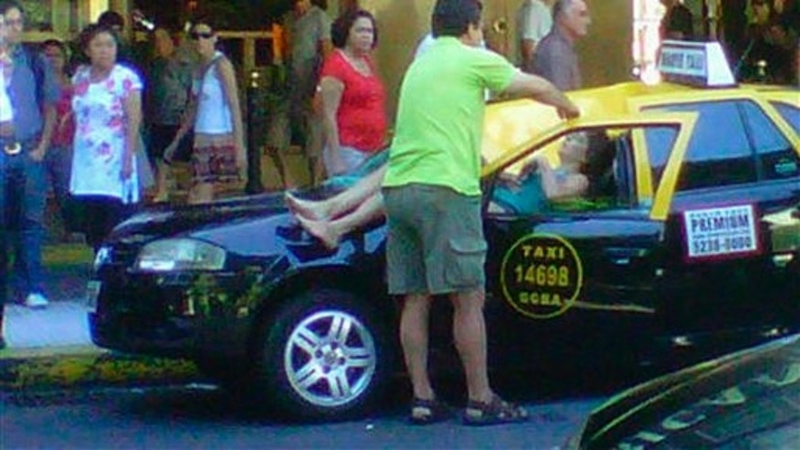 Jan. 24, 2011: Cell phone photo provided by Infobae.com received via Twitter from @denisitabaires shows a woman lying on a taxi after falling from the 23rd floor of a hotel in downtown Buenos Aires, Argentina. The seriously injured woman was taken to a hospital while the taxi driver managed to get out of the car before the impact.