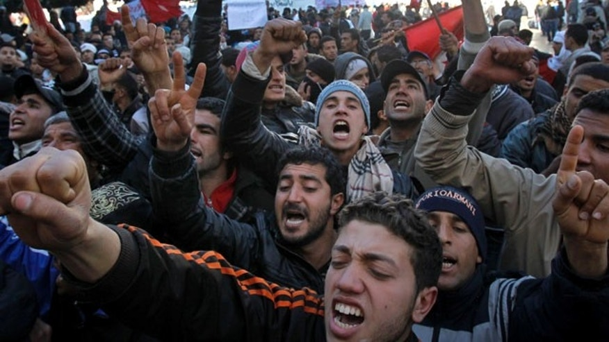 Jan. 24, 2011: Protestors shout slogans during a demonstration in Tunisia.