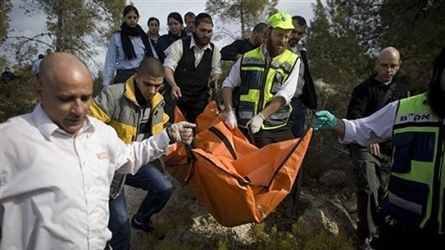 Dec. 19, 2010: Israeli rescue workers carry the body of U.S. tourist Kristine Luken after she was found in a wooded area near the village of Mata, outside Jerusalem.