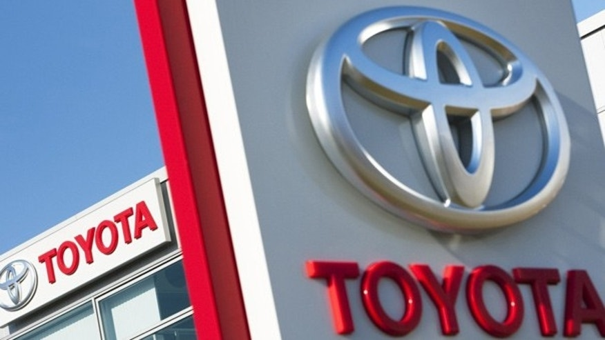 Toyota logos are pictured at a dealership.