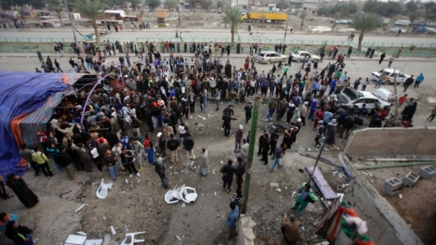 Jan. 27: People gather at the scene of a car bomb attack in Baghdad, Iraq.