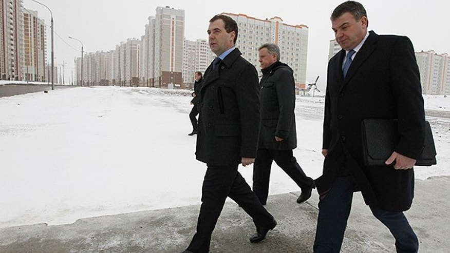 Jan. 12: Russian President Dmitry Medvedev flanked by Defense Minister Anatoly Serdyukov, right, and Moscow region Governor Boris Gromov, background, views apartment buildings constructed for Russian servicemen in Podolsk near Moscow.