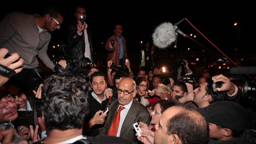 Jan. 27, 2011: Former Director General of the International Atomic Energy Agency, IAEA, and Nobel Peace Prize winner Mohamed ElBaradei talks to members of the media as he arrives at Cairo's airport in Egypt, from Austria. ElBaradei told reporters that the regime has not been listening. He urged the Egyptian regime to exercise restraint with protesters, saying they have been met with a good deal of violence which could lead to an explosive situation. (AP)