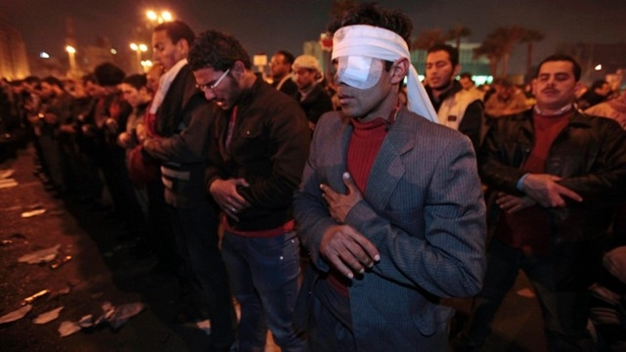 Jan. 30: A protester, who said he was wounded during clashes with police in the previous days, prays with other protesters in Tahrir square in downtown Cairo, Egypt.
