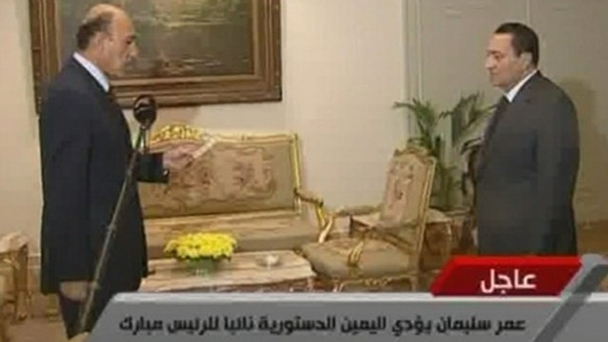 Jan. 29: In this image taken from TV, Egyptian President Hosni Mubarak, right, listens as Omar Suleiman swears the oath as Vice President of Egypt.