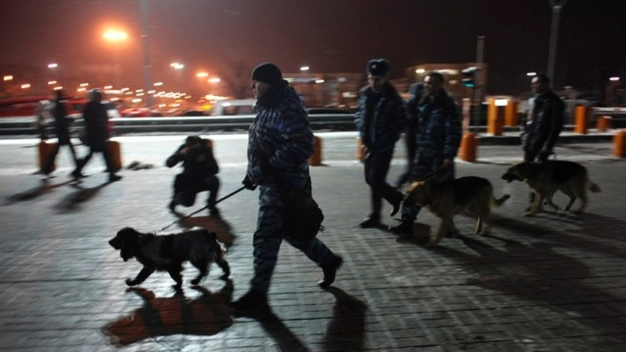 Jan. 24, 2011: Police officers with sniffer dogs walk at Domodedovo airport in Moscow