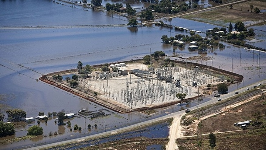 Jan. 18: In this photo provided by the State Emergency Service, a levee is in place around a power substation in an attempt to hold back water from the swollen Loddon River at Kerang, Australia.