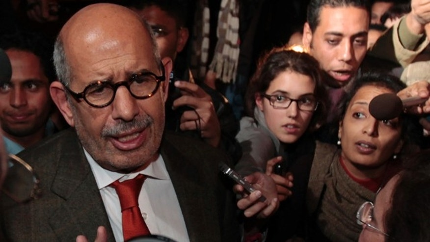 Jan. 27: Former Director General of the International Atomic Energy Agency, IAEA, and Nobel Peace Prize winner Mohamed ElBaradei talks to members of the media as he arrives at Cairo's airport in Egypt, from Austria.