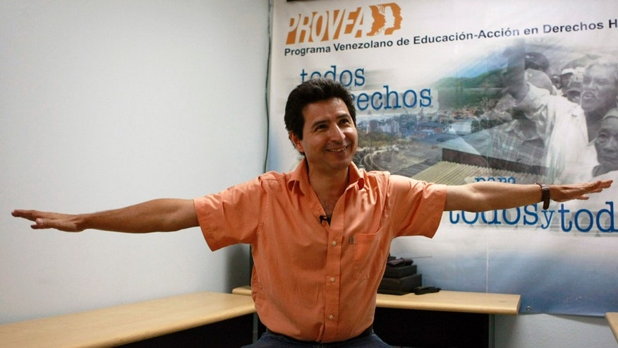 "** ADVANCE FOR USE MONDAY, JAN. 31, 2011 AND THEREAFTER ** In this photo taken on Jan. 12, 2011, Marino Alvarado, leader of the human rights group Provea, gestures during an interview in his office in Caracas, Venezuela. Venezuelan activists fear that a new law, which prohibits funding from abroad for organizations that promote or defend ""political rights,"" gives Venezuela's President Hugo Chavez a powerful tool to potentially limit their work by restricting their funding. (AP Photo/Fernando Llano)"