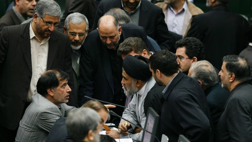 Feb. 1: Iranian lawmakers talk in an open session of parliament to debate on impeachment of Transportation Minister Hamid Behbahani, unseen, in Tehran, Iran.