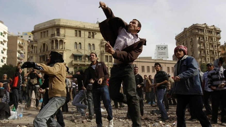 Feb. 3: Anti-government protestors throw stones during clashes in Cairo, Egypt. Egypt's prime minister apologized for an attack by government supporters on protesters in a surprising show of contrition Thursday, and the government offered more concessions to try to calm the wave of demonstrations demanding the ouster of President Hosni Mubarak. (AP)