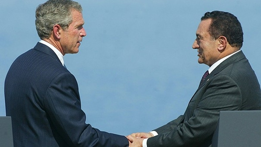 In a June 3, 2003 file photo, U.S. President George W. Bush shakes hands with Egyptian President Hosni Mubarak during the Multilateral Summit in Sharm El-Sheikh, Egypt.