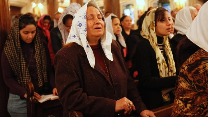 Jan. 30, 2011: Coptic Christians attend a service at a church in the Rod El Faray neighborhood in Cairo.