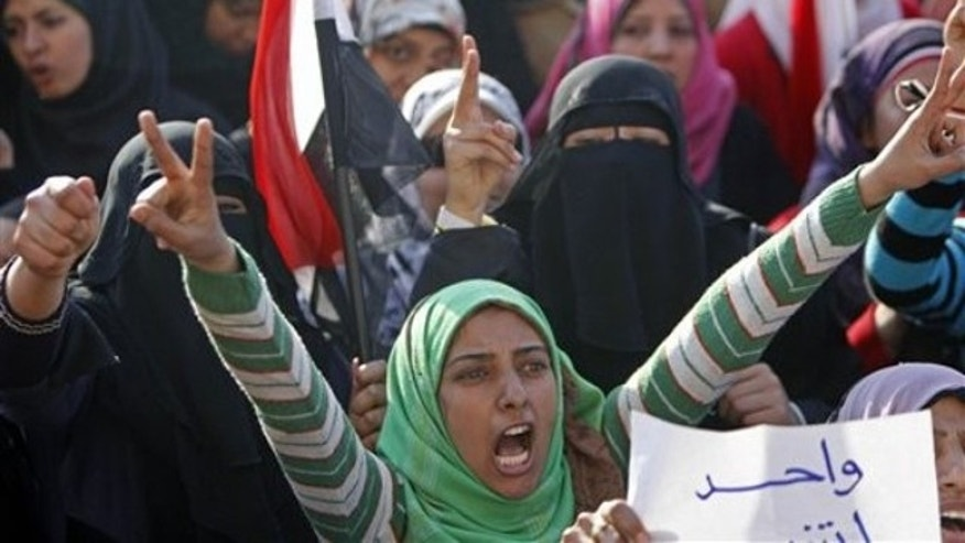 Feb. 13: An anti-government protestor shouts during a demonstration against the evacuation in Cairo. Egypt's military moved Sunday to restore order in Cairo after weeks of mass demonstrations and two days after Mubarak surrendered power to the military but still some refused to leave Tahrir square (Reuters).