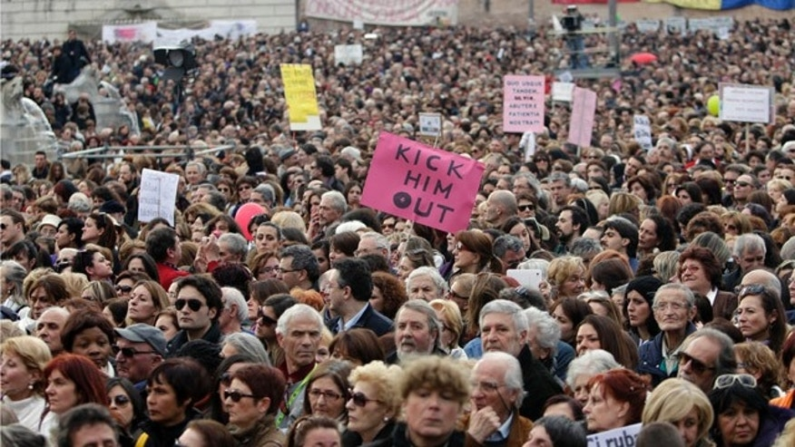 Feb. 13, 2011: People march against Italian premier Silvio Berlusconi during a protest in Rome. Thousands of women turned out in 200 Italian cities to denounce what they say is Berlusconi's debasing of females.