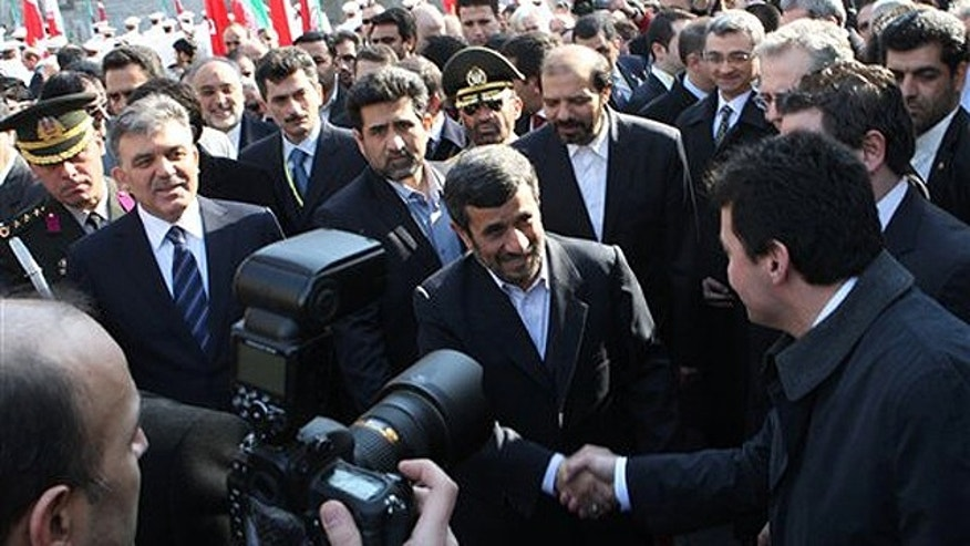 Feb. 14: Iranian President Mahmoud Ahmadinejad, center, greets the Turkish delegation as his Turkish counterpart Abdullah Gul, second left, looks on, during an official welcoming ceremony for him, in Tehran, Iran. (AP)